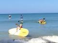boat-paddling-ocean-comingin