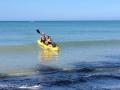 boat-paddling-ocean-wave-1024x767